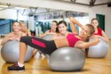 smiling female instructor with fitness ball