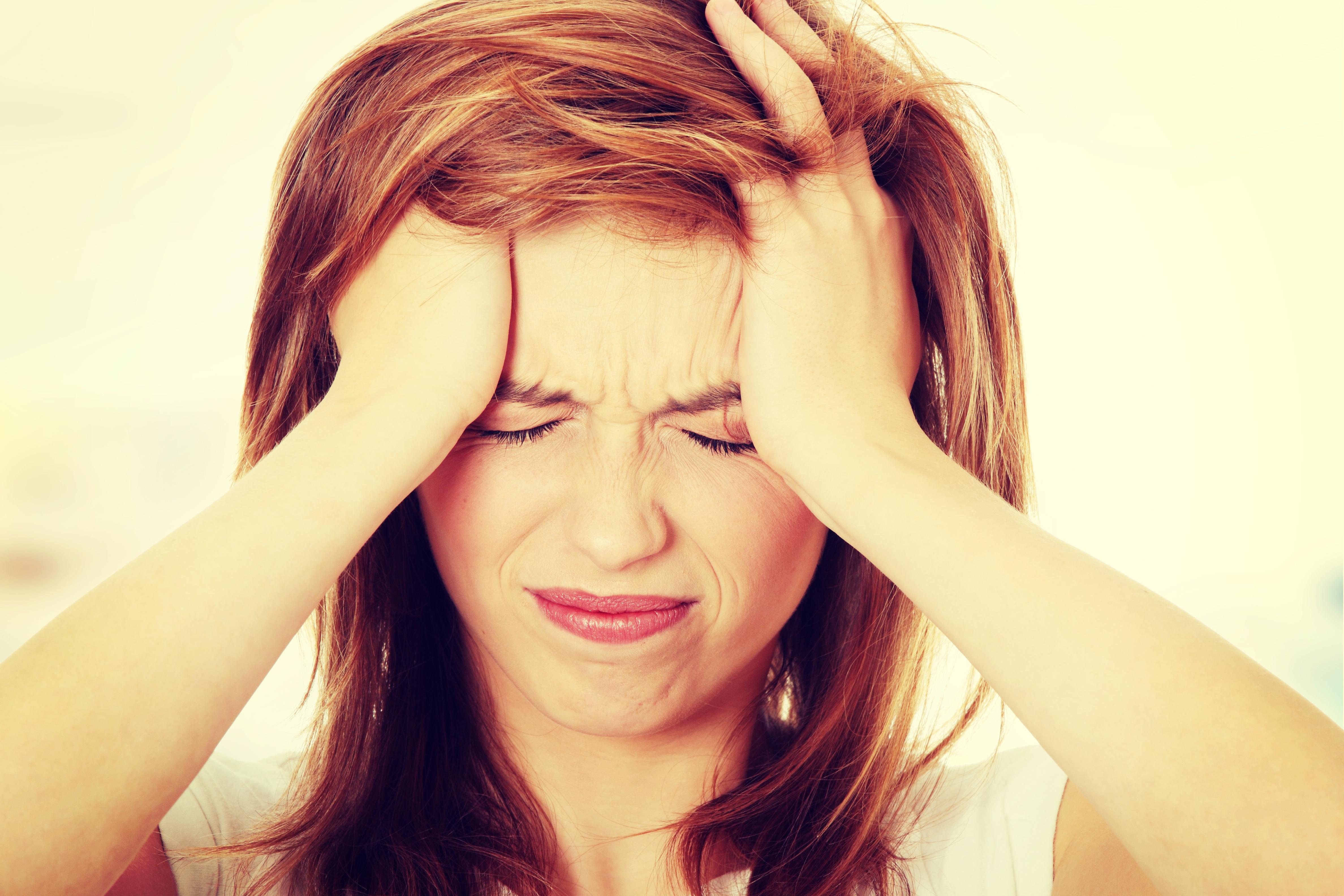 wat te doen tegen hoofdpijn en misselijkheid