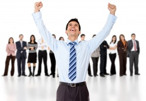 Businessman with arms up
